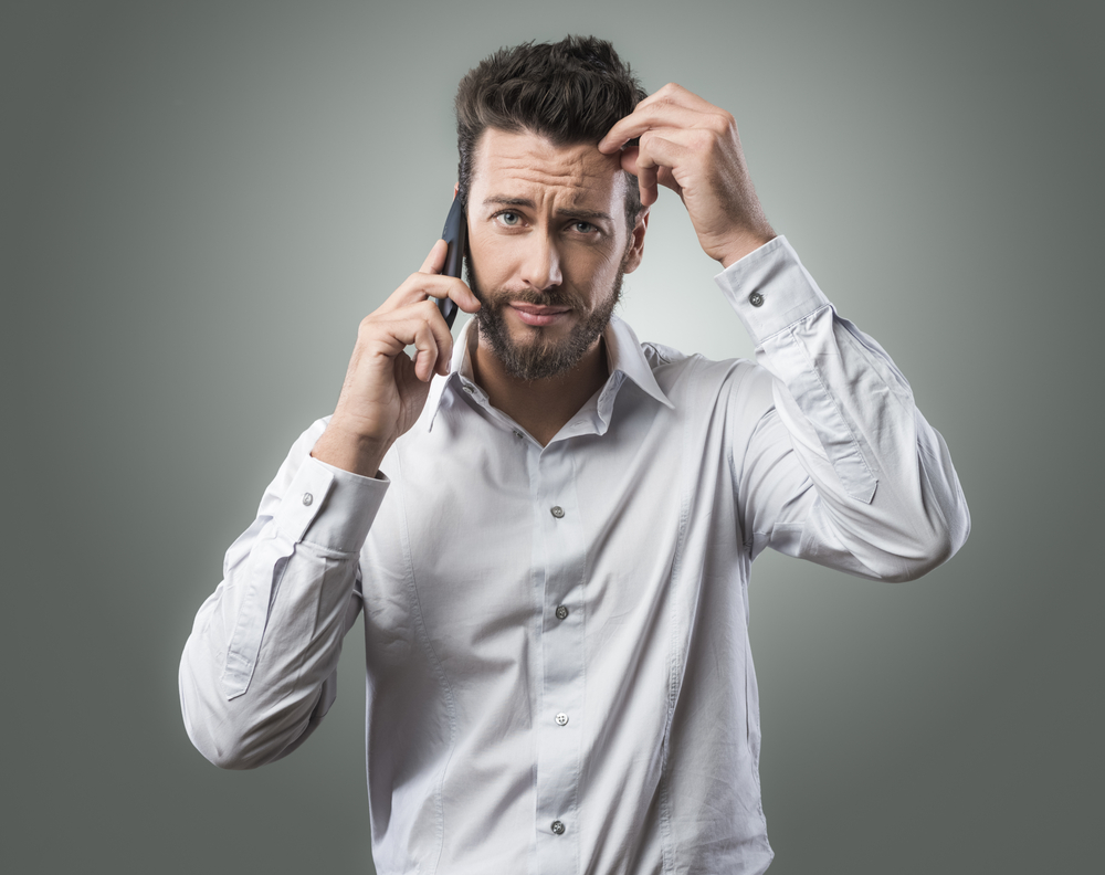 frustrated man on hold